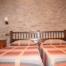 Habitació doble amb dos llits individuals de'El Racó de Cal Maró'