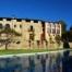 Masia Campalans i zona piscina. És on es troba la recepció del càmping, restaurant, bar, supermercat,...