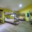 Habitació 'Montsant' de LoRefugi. Acollidora i espaiosa, amb capacitat per a 10 persones.