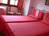 Habitació doble amb dos llits.
