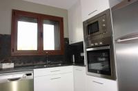 Cuina totalment equipada (rentaplats,nevera, forn, microones, rentadora i assecadora