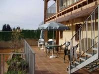 L'àmplia Terrassa de 214 m2, a l'exterior de la casa.