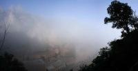 Panoràmica del Monestir de Montserrat amb la boira del matí.